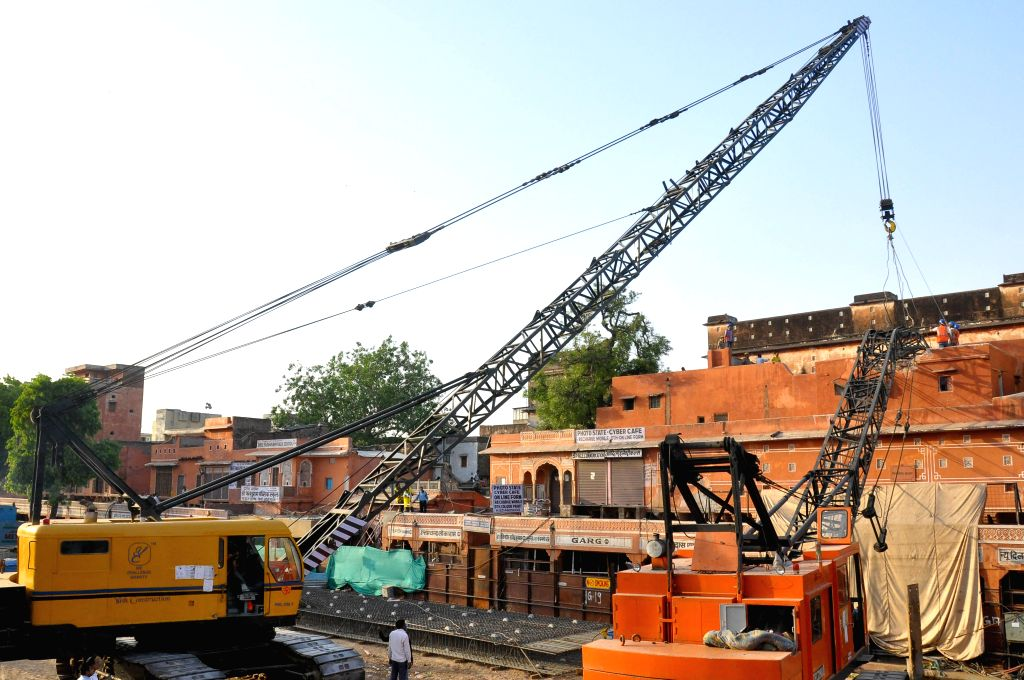 A crane that collapsed on a house near an under-construction metro rail site in Jaipur being lifted on May 4, 2015.