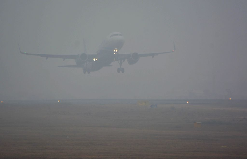 An aeroplane takes off from Jaipur airport on a foggy day on Dec 31, 2014.