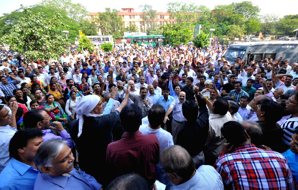 Bank Employees demonstrate in front of a bank during a day-long strike called to press for their demands, including pay revision in Jaipur, on Nov 12, 2014. Employees of 27 public sector ...