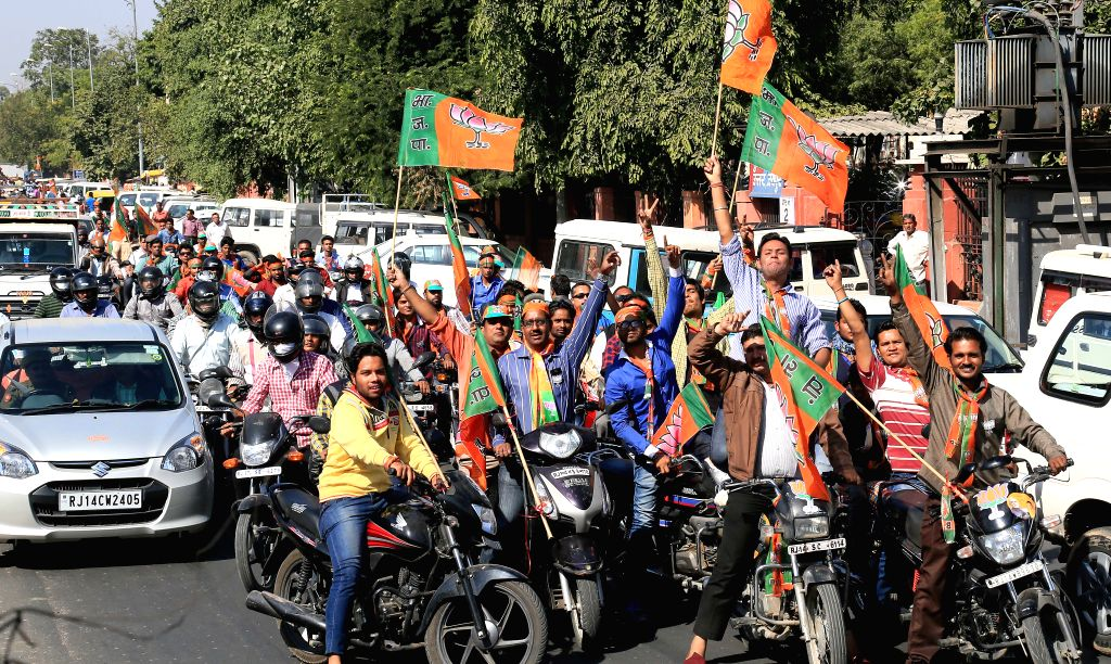 BJP workers during an election campaign rally for local municipal elections in Jaipur on Nov. 20, 2014.