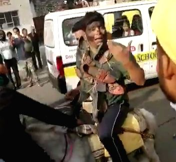 Jaipur: BSP workers blackened the face of Ram Gautam, party's national coordinator and Sita Ram Sila (state in charge) and paraded them on donkey putting garlands of shoes and slippers in their neck in front of state party headquarter, in Jaipur on O