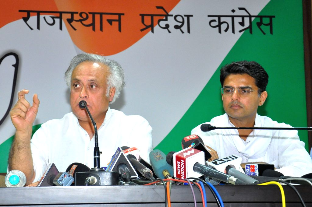 Congress leader Jairam Ramesh and Rajasthan Congress chief Sachin Pilot address a press conference regarding land acquisition bill at PCC headquarters in Jaipur, on March 28, 2015.