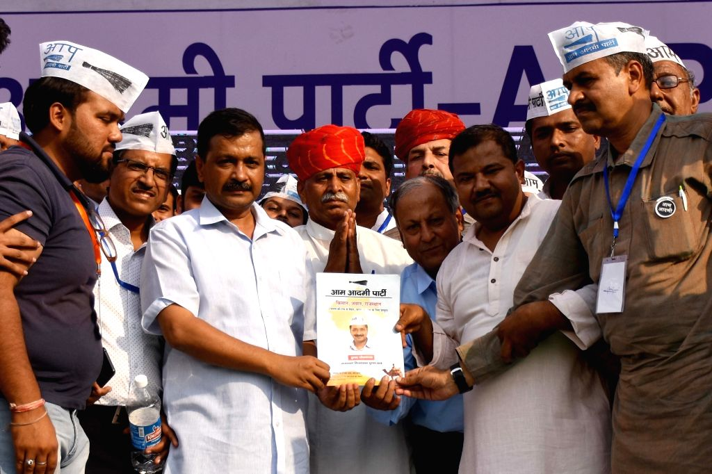 : Jaipur: Delhi Chief Minister and Aam Aadmi Party (AAP) chief Arvind Kejriwal releases the party's manifesto ahead of Rajasthan Assembly elections, at a public meeting in Jaipur, on Oct 28, ...