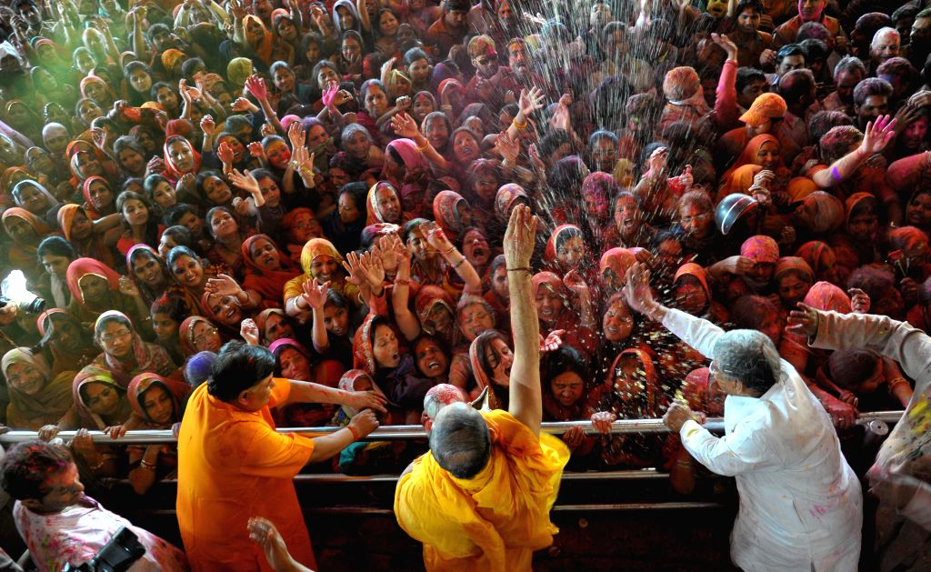 Devotees celebrate Holi at the Govind Devji temple in Jaipur, on March 5, 2015.