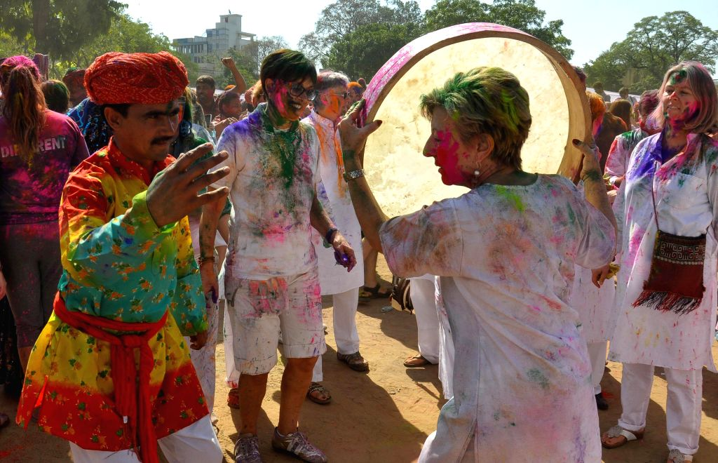 Foreigners celebrate Holi in Jaipur, on March 6, 2015.