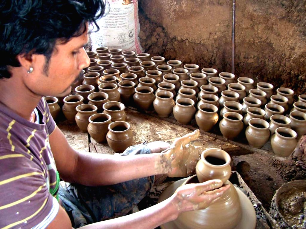 Jaipur, May 8 (IANS) Two brothers, potters by profession, have been sleeping under open sky for 40 days in Jaipur during lockdown along with their unsold stock of beautifully made earthen pots, clay bottles and home decor, hoping they would earn some