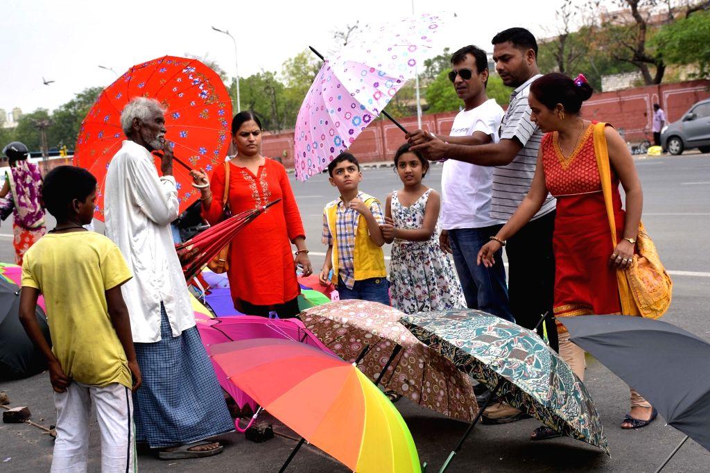 Jaipur : People buy umbrellas before monsoon hits Jaipur, on July 4, 2016.