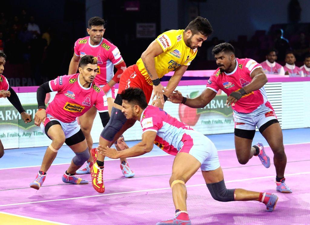 Jaipur: Players in action during Pro Kabaddi Season 7 match between Jaipur Pink Panthers and Gujarat Fortunegiants at Sawai Mansingh Indoor Stadium in Jaipur on Sep 21, 2019. (Photo: IANS)