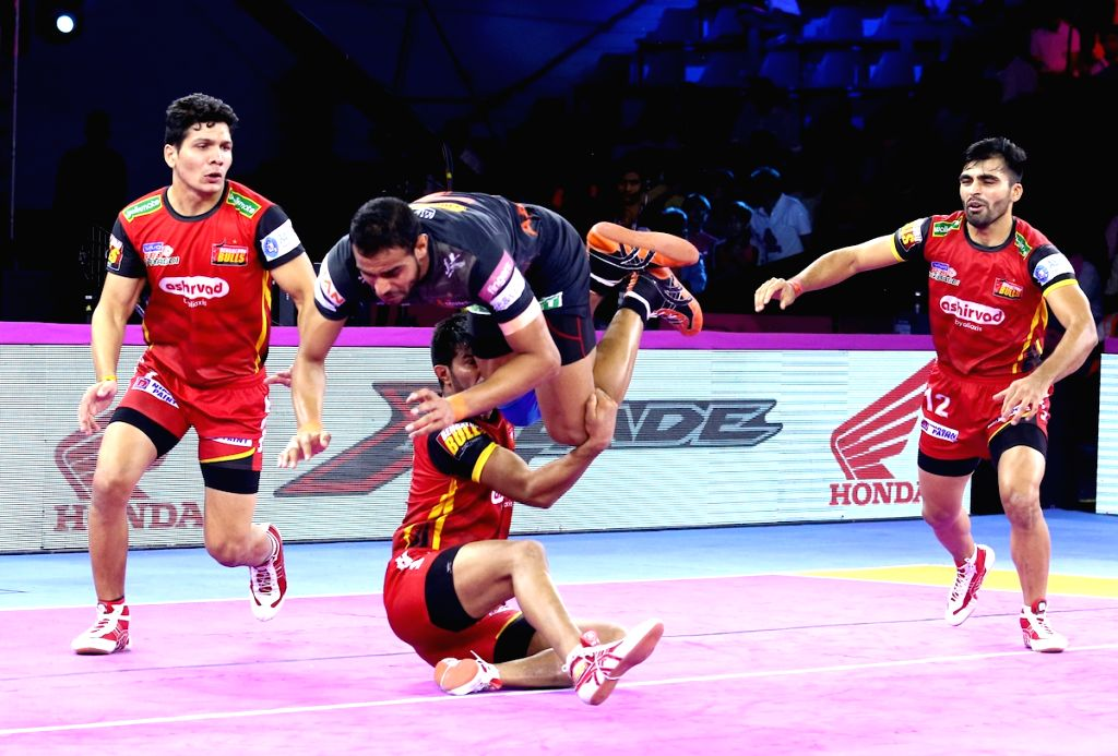 Jaipur: Players in action during Pro Kabaddi Season 7 match between U Mumba and Bengaluru Bulls at Sawai Mansingh Indoor Stadium in Jaipur on Sep 27, 2019. (Photo: IANS)