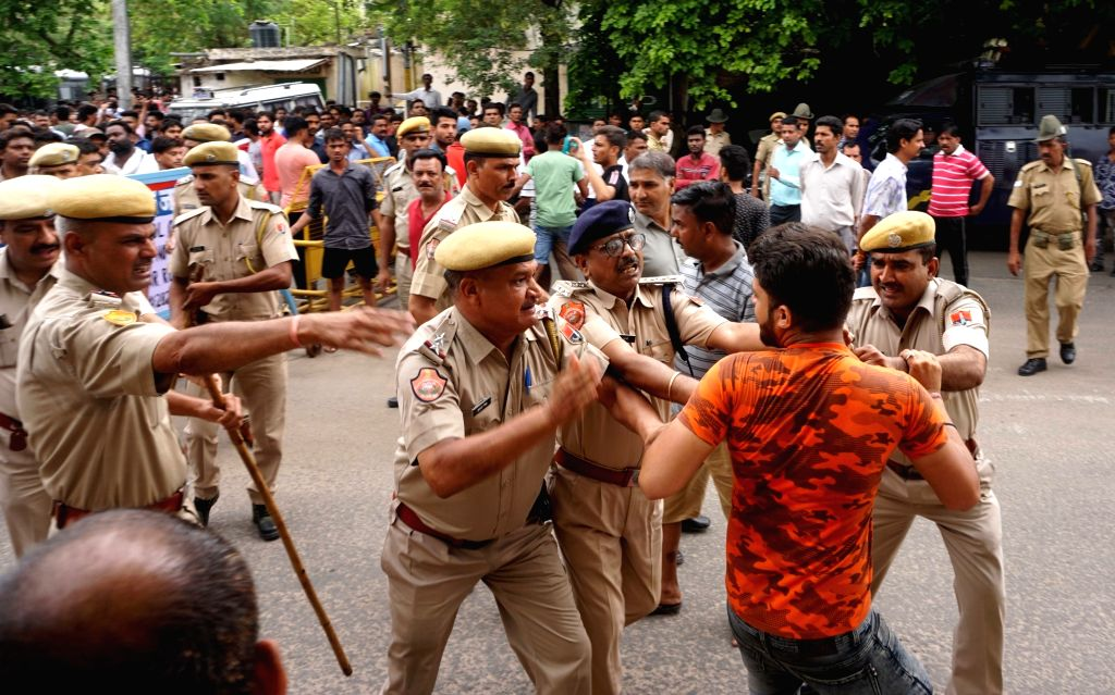 Jaipur: Police chase away people protesting against the rape of a minor in Shastri Nagar area of Jaipur on July 2, 2019. (Photo: Ravi Shankar Vyas/IANS)