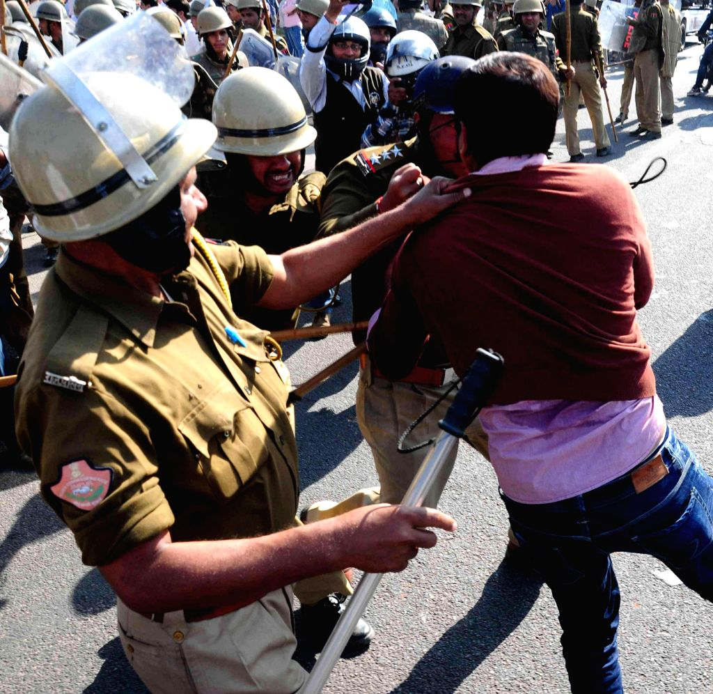 Police takes away a student demonstrating against the police after Rajasthan High Court quashed the University polls held earlier, in Jaipur on Nov 28, 2014. Court found that Lyngdoh ...