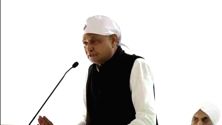 Jaipur: Rajasthan Chief Minister Ashok Gehlot addresses during the Shabad Kirtan programme organised at the Chief Minister's Residence in Jaipur on Dec 4, 2019. (Photo: IANS) - Ashok Gehlot