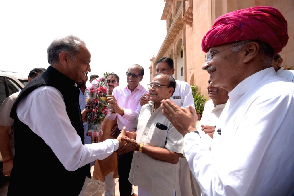 Jaipur: Rajasthan Chief Minister Ashok Gehlot being welcomed on his arrival at the state assembly on the first day of the Budget Session, in Jaipur on June 27, 2019. (Photo: Ravi Shankar Vyas/IANS) - Ashok Gehlot