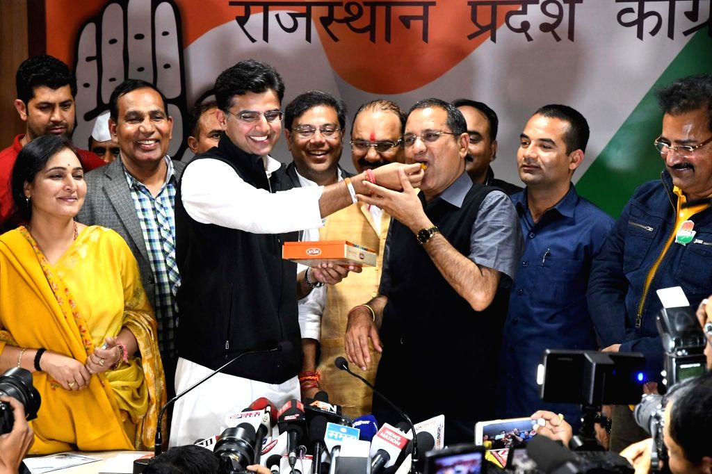 : Jaipur: Rajasthan Congress unit President Sachin Pilot celebrates after the party raced ahead of the BJP in the Lok Sabha constituencies of Ajmer and Alwar and the Mandalgarh Assembly seat in ...