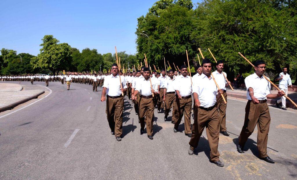 Jaipur: RSS volunteers participate in a march organised on Vijayadasami in Jaipur, on Oct 11, 2016. (Photo: Ravi Shankar Vyas/IANS)