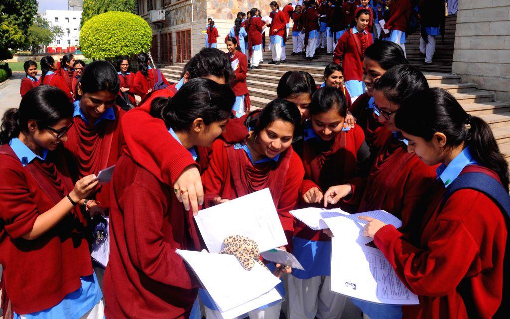 Students discuss question paper after coming out of examination hall in Jaipur, on March 2, 2015. CBSE board exams commenced today.