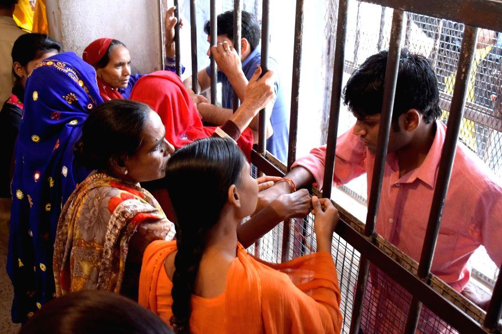 """Jaipur: The sisters of the inmates of Jaipur Central Jail meet them on """"Bhai Dooj"""" on Nov 13, 2015. (Photo: Ravi Shankar Vyas/IANS)"""