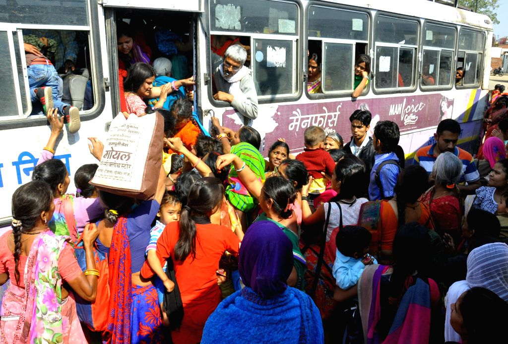 Women board a bus  at a Jaipur bus stand on March 8, 2015. The Rajasthan government is providing free bus ride for women passengers across the state on International Women's Day.