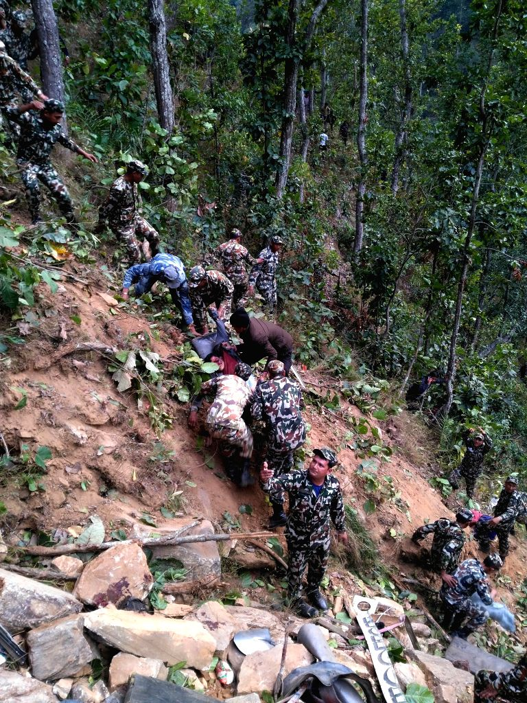 JAJARKOT, March 10, 2017 - People carry the wounded to safer place at the site of a bus accident at Malika Municipality of Jajarkot district in Mid-Western Nepal, March 9, 2017. At least 20 persons ... - Malik