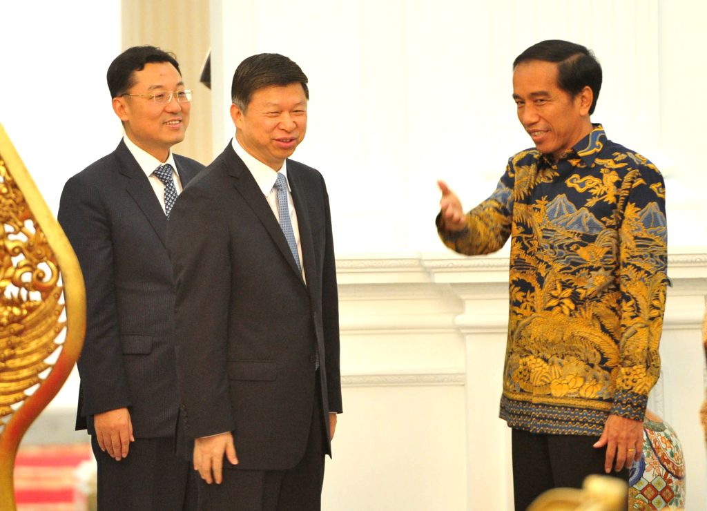 JAKARTA, April 14, 2016 - Indonesian President Joko Widodo (R) welcomes Song Tao (C), the head of the International Department of the Communist Party of China (CPC) Central Committee who is ...