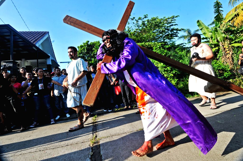 Indonesian Catholic devotees perform during a passion play on Good Friday to mark Easter in Jakarta, Indonesia, April 18, 2014. Passion play is a dramatic ...