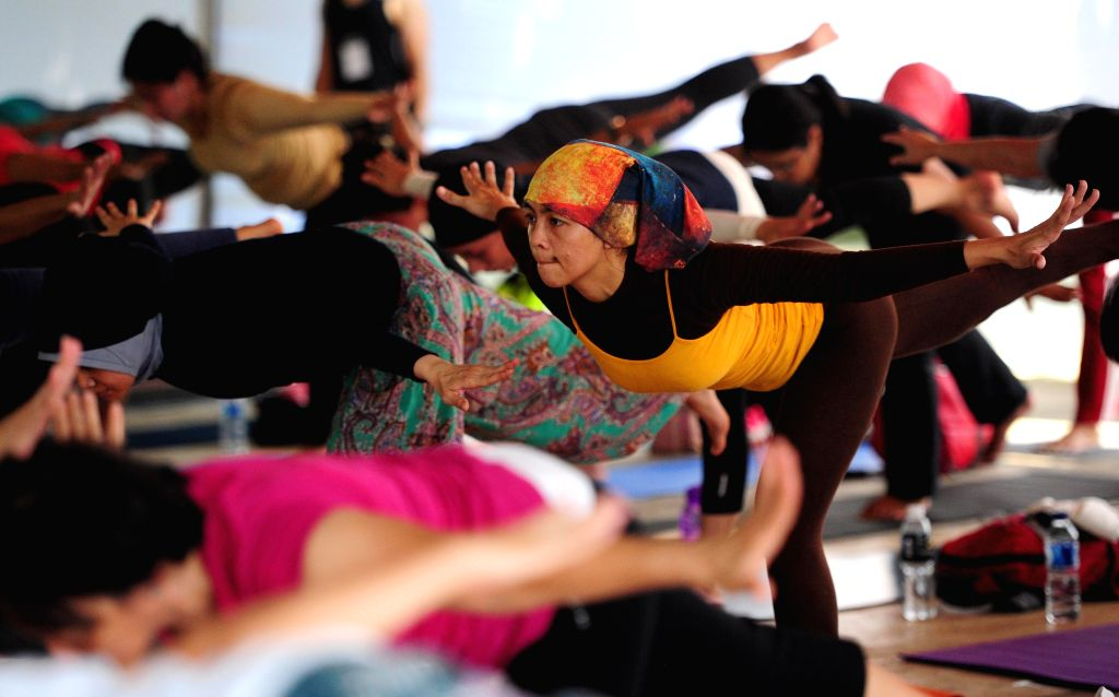 Participants practice during the Yoga Gembira Festival 2014 in Jakarta, Indonesia, April 18, 2014. The event is held from April 18 to 20, 2014. ...