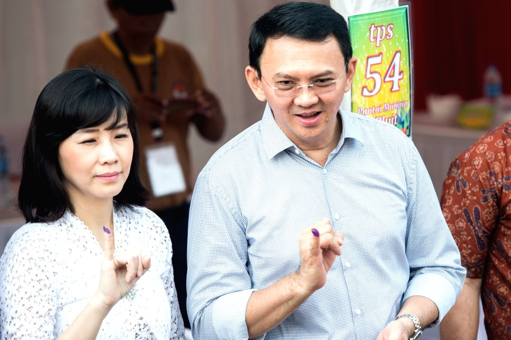 JAKARTA, April 19, 2017 - Basuki Tjahaja Purnama (R) and his wife Veronica Tan show their fingers after casting their votes in Jakarta, Indonesia, April 19, 2017. Millions of residents in the ... - Anies Baswedan