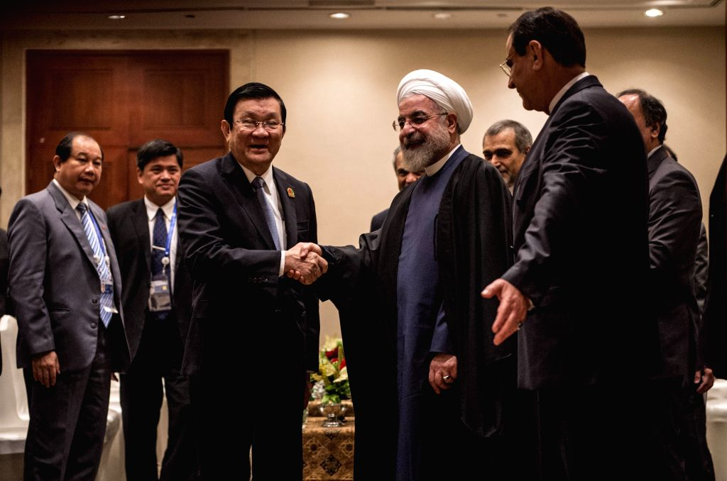 Iranian President Hassan Rouhani (R, center) shakes hands with Vietnamese President Truong Tan Sang (L, center) on the sidelines of the Asian-African Summit 2015 ... - Hassan Rouhani