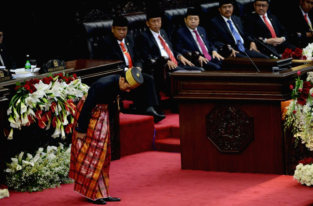 JAKARTA, Aug. 16, 2017 - Indonesian President Joko Widodo(1st L) bows to the audiences after his annual speech at the parliament building in Jakarta, Indonesia, Aug. 16, 2017.