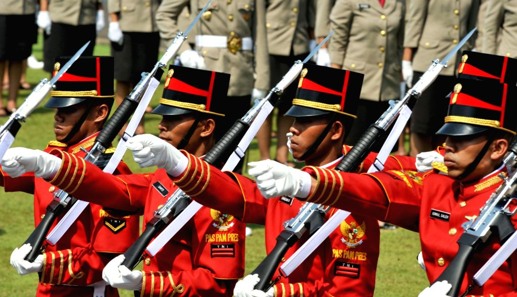 Members of Indonesian honour guards parade during a celebration of the country's 68th independence anniversary at the Presidential Palace in Jakarta, ...
