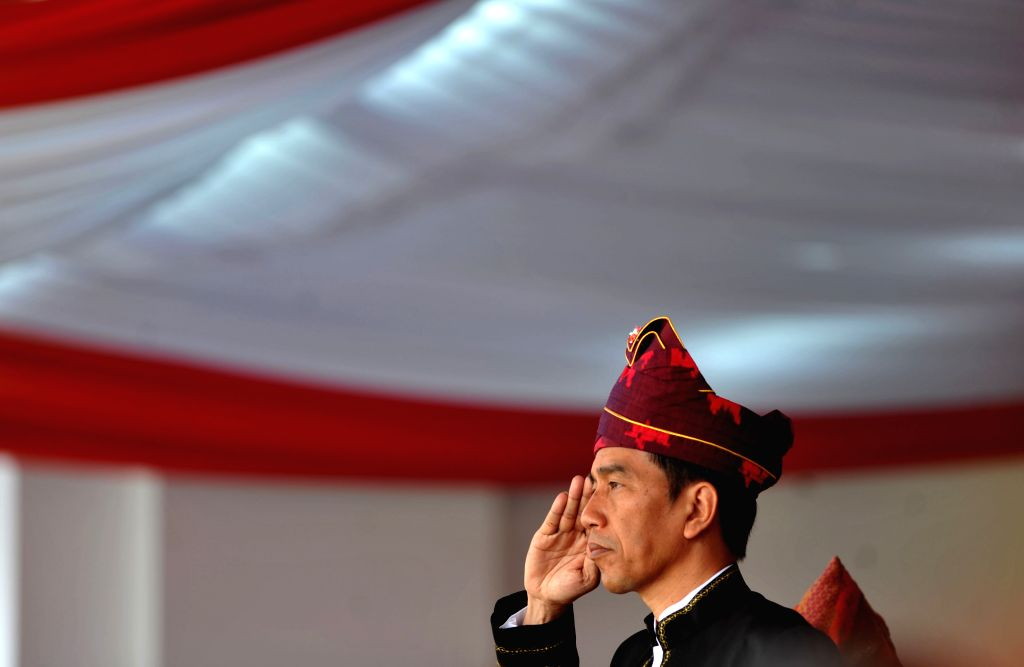 JAKARTA, Aug. 17, 2017 - Indonesian President Joko Widodo salutes during the ceremony to mark the 72nd Independence Day of Indonesia at Merdeka Palace in Jakarta, Indonesia, Aug. 17, 2017.