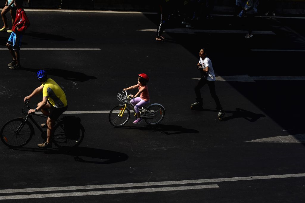 JAKARTA, Aug. 25, 2019 - People take part in the Car Free Day event in Jakarta, Indonesia, Aug. 25, 2019. The event aimed at raising environmental awareness among citizens.