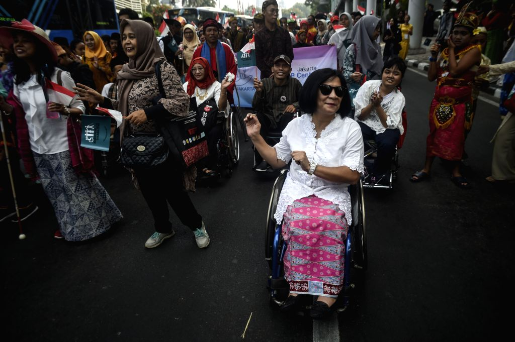 JAKARTA, Aug. 27, 2019 - People with disabilities take part in a rally in Jakarta, Indonesia, Aug. 27, 2019. Indonesians with disabilities appealed to the government during a rally on Tuesday to help ...