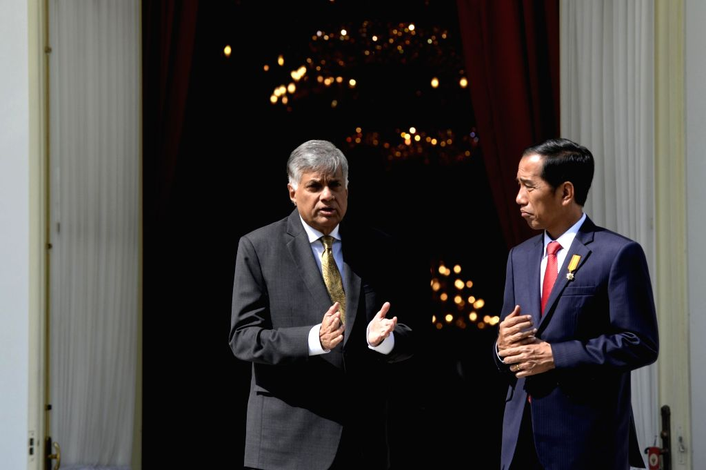 JAKARTA, Aug. 3, 2016 - Indonesian President Joko Widodo (R) talks with visiting Sri Lankan Prime Minister Ranil Wickremesinghe at the backyard of the Presidential Palace in Jakarta, Indonesia, Aug. ... - Ranil Wickremesingh