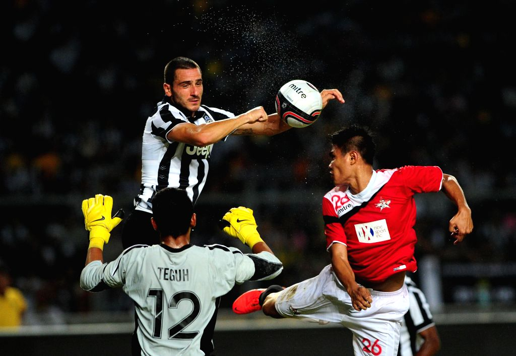 Juventus's Leonardo Bonucci (upper) vies with Indonesia ISL All-Stars players during a friendly football match at Bung Karno stadium in Jakarta, Indonesia, Aug. 6, ..