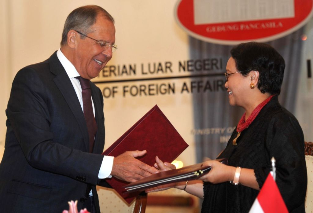 JAKARTA, Aug. 9, 2017 - Russian Foreign Minister Sergei Lavrov (L) shakes hands with Indonesian Foreign Minister Retno Marsudi after signing a memorandum of understanding in Jakarta, Indonesia, Aug. ... - Sergei Lavrov