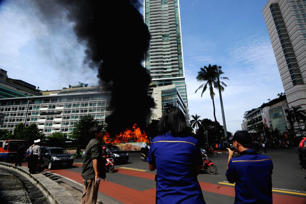 JAKARTA, Dec. 16, 2013 (Xinhua) -- A bus is on fire in the main road of Sudirman Street in Jakarta, Indonesia, Dec. 16, 2013. There were no fatalities in this accident. (Xinhua/Veri Sanovri)
