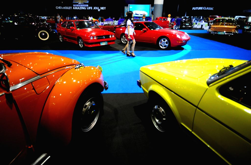 People visit the 7th Indonesia Classic Car Show 2013 in Jakarta, Indonesia, Dec. 20, 2013. The biggest and largest International classic car show in South East