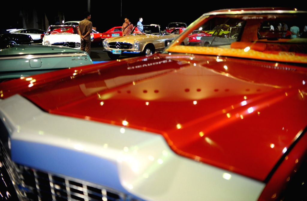 Visitors look at classic cars at the 7th Indonesia Classic Car Show 2013 in Jakarta, Indonesia, Dec. 20, 2013. The biggest and largest International classic ...