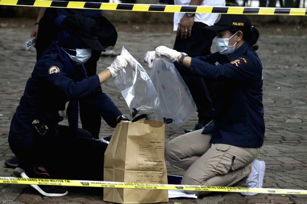 JAKARTA, Dec. 3, 2019 - Indonesian police officers collect some evidences at the smoke grenade explosion site in Jakarta, Indonesia, Dec. 3, 2019. An explosion resulted from a smoke grenade took ...
