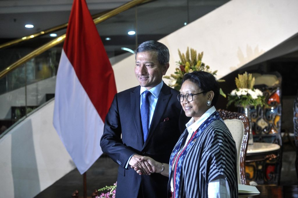 JAKARTA, Feb. 14, 2018 - Singapore's Foreign Minister Vivian Balakrishnan (L) shakes hands with Indonesian Foreign Minister Retno Marsudi during their meeting at the Ministry of Foreign Affairs in ... - Vivian Balakrishnan
