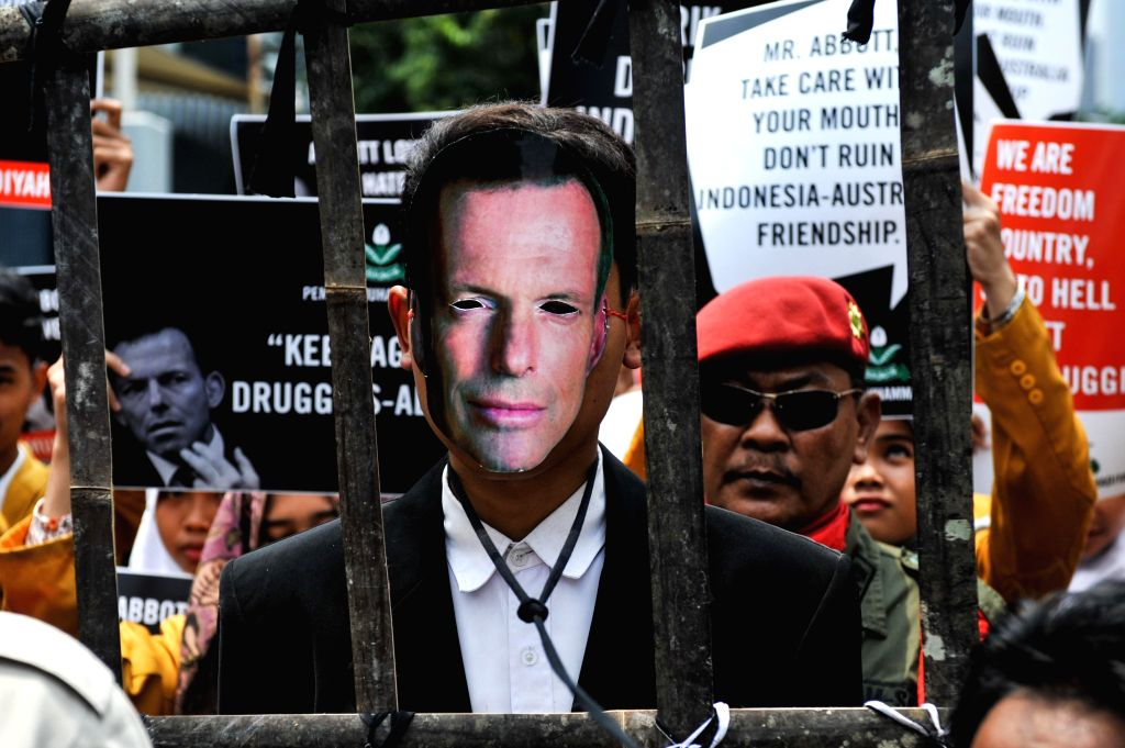 A protester wears a mask of Australian Prime Minister Tony Abbott during a rally to protest a statement made by Abbott which ask Indonesia to cancel the execution ... - Tony Abbott