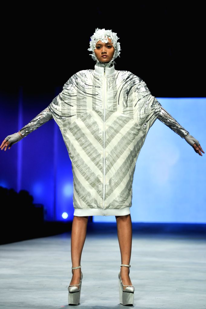 JAKARTA. Feb. 27, 2015 A model presents a creation by designer Ivan Gunawan during the Indonesian Fashion Week 2015 at Jakarta Convention Center in Jakarta, Indonesia, Feb. 26, 2015. ...
