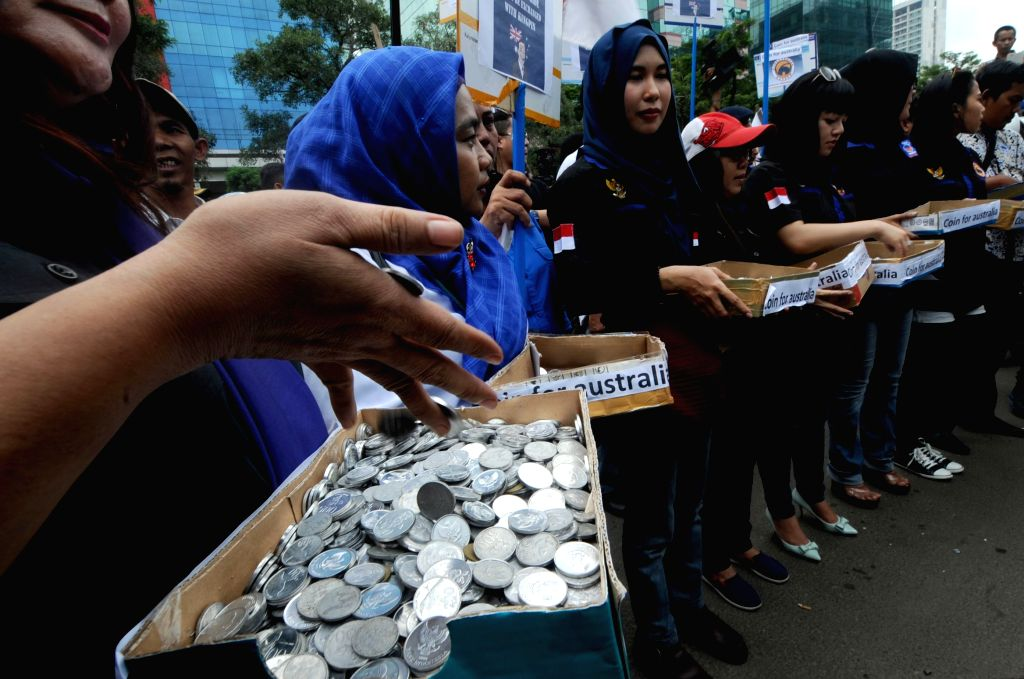 Indonesian women collect coins during a rally at the Australian Embassy in Jakarta, Indonesia, Feb. 27, 2015. Indonesians were mobilized in record numbers to ... - Tony Abott