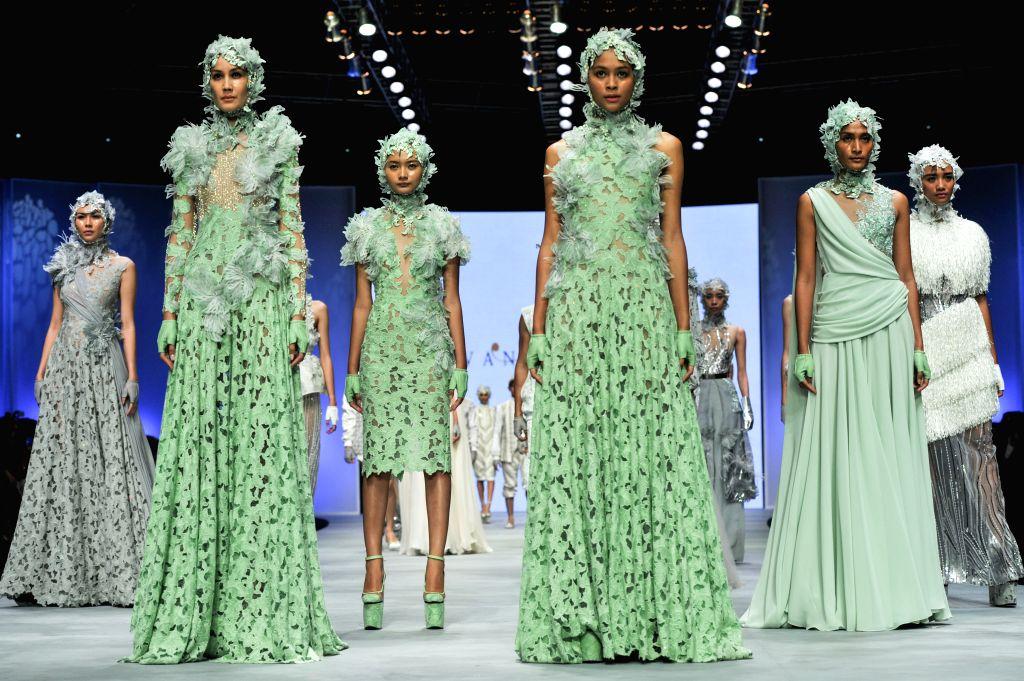 JAKARTA. Feb. 27, 2015 Models present creations by designer Ivan Gunawan during the Indonesian Fashion Week 2015 at Jakarta Convention Center in Jakarta, Indonesia, Feb. 26, 2015. ...