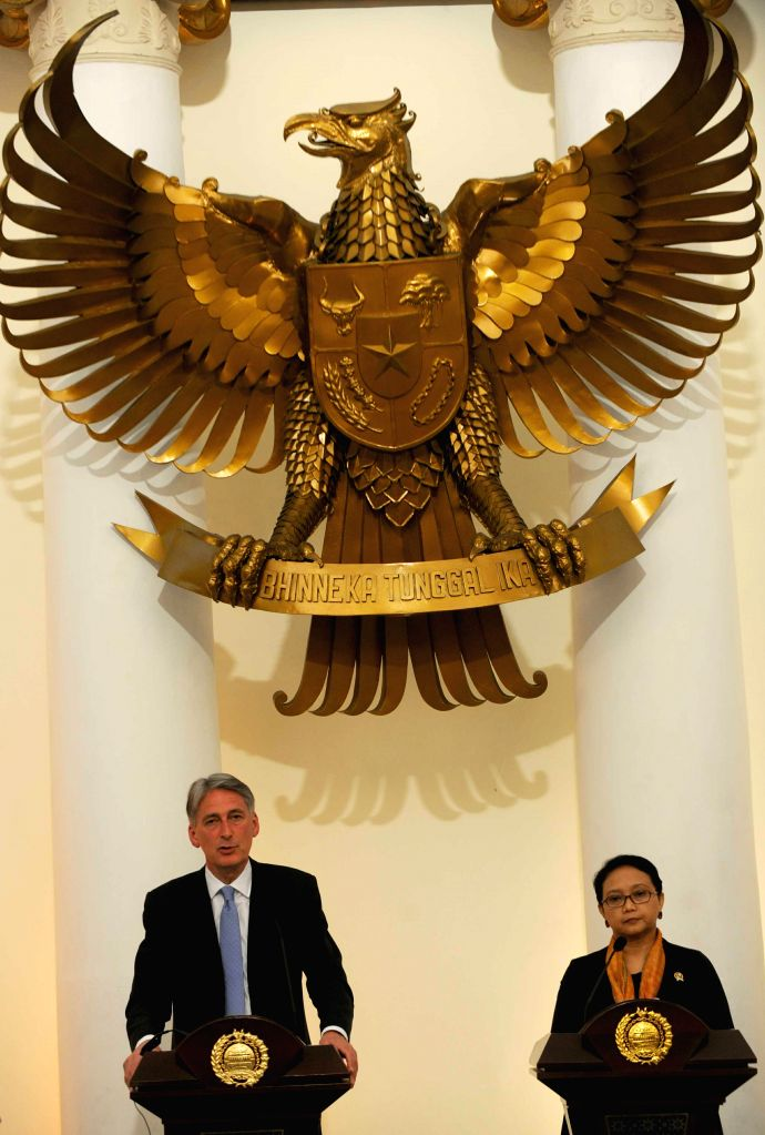 Indonesian Foreign Minister Retno Marsudi (R) and British Foreign Secretary Philip Hammond attend a joint press conference after their meeting in Jakarta, Indonesia, - Retno Marsudi