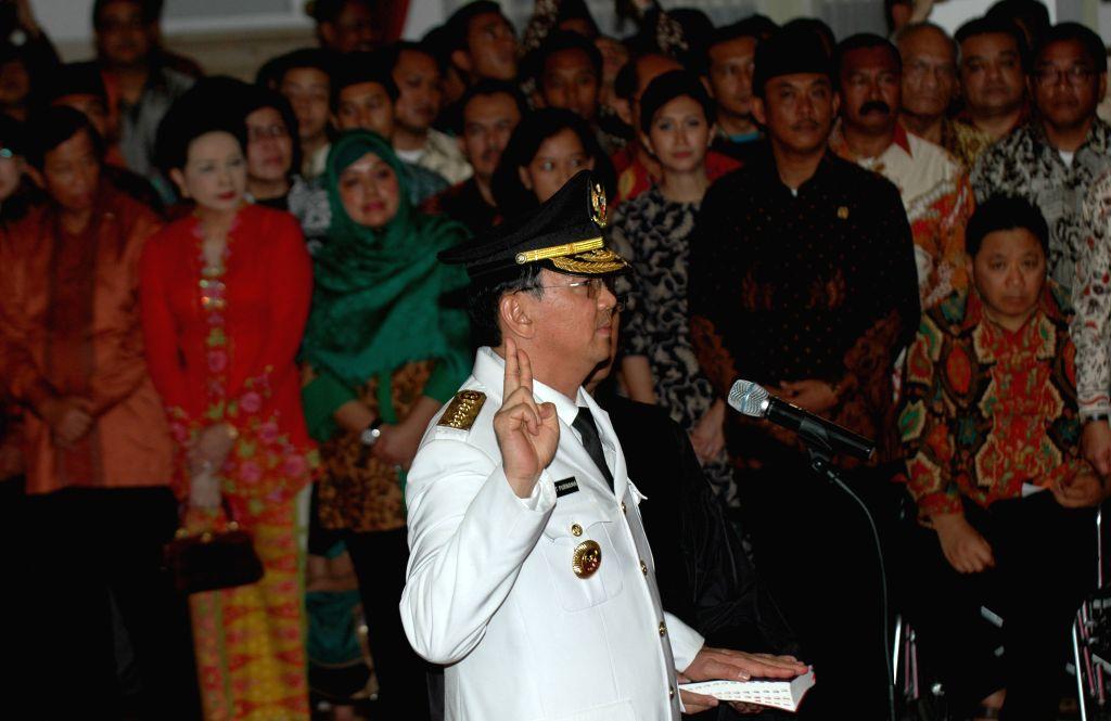 "Jakarta (Indonesia): New Jakarta governor Basuki Tjahaja Purnama better known by his nickname ""Ahok"" swears during the inauguration ceremony at President palace in Jakarta, Indonesia, Nov. ."
