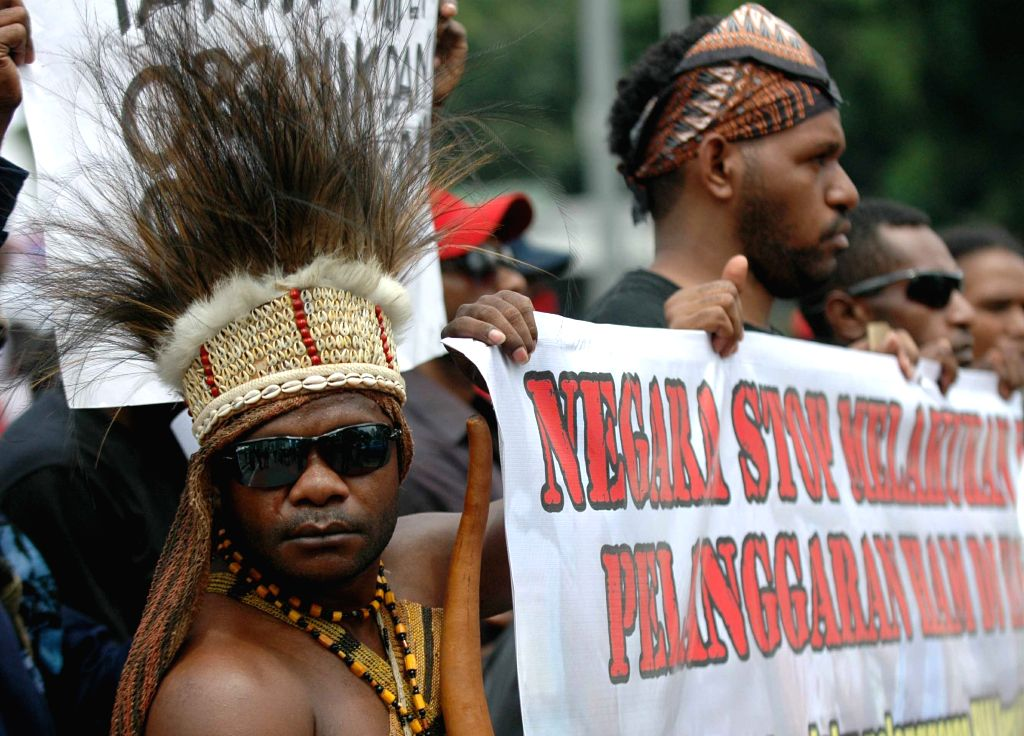 Jakarta (Indonesia): Papuan students take part in a rally marking the International Human Rights Day in Jakarta, Indonesia, Dec. 10, 2014. Papuan students ask for attention from the government after .