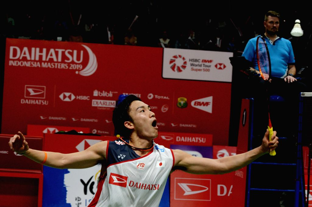 JAKARTA, Jan. 25, 2019 - Kento Momota of Japan returns the shuttlecock during the men's singles quarterfinal against Anthony Sinisuka Ginting of Indonesia at the Indonesia Masters 2019 in Jakarta, ...