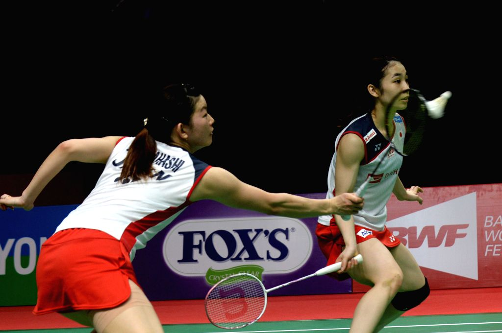 JAKARTA, Jan. 26, 2019 - Ayaka Takahashi (L) and Misaki Matsutomo of Japan compete during the women's doubles semifinal match against Greysia Polii and Apriyani Rahayu of Indonesia at the Indonesia ...